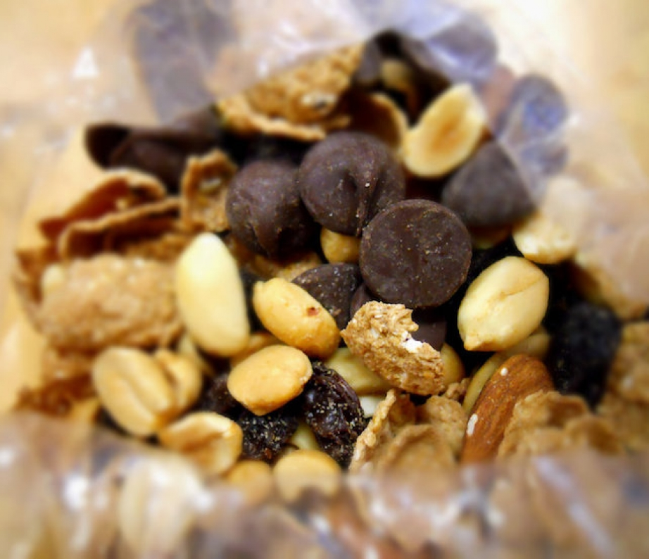 snacks for a paddling trip include almonds, banana chips and cranberries in a glass jar.