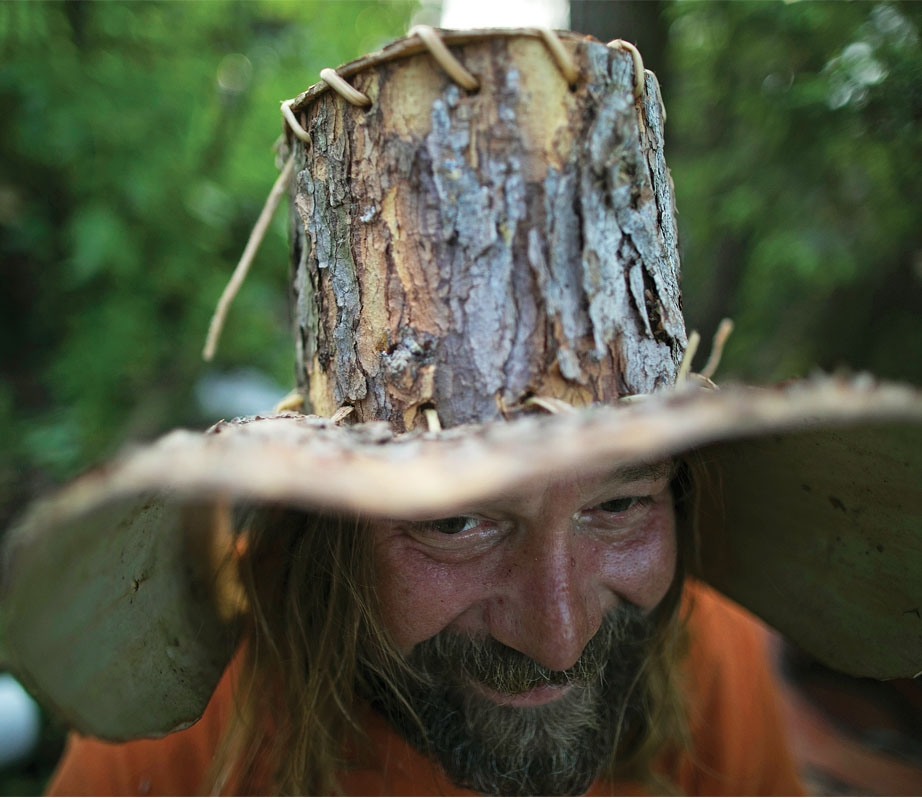 Mike Ranta Wearing Hat Made From Bark Of Tree