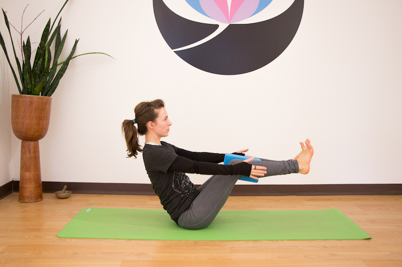 Boat pose, a useful yoga poses for kayakers to do during the off season