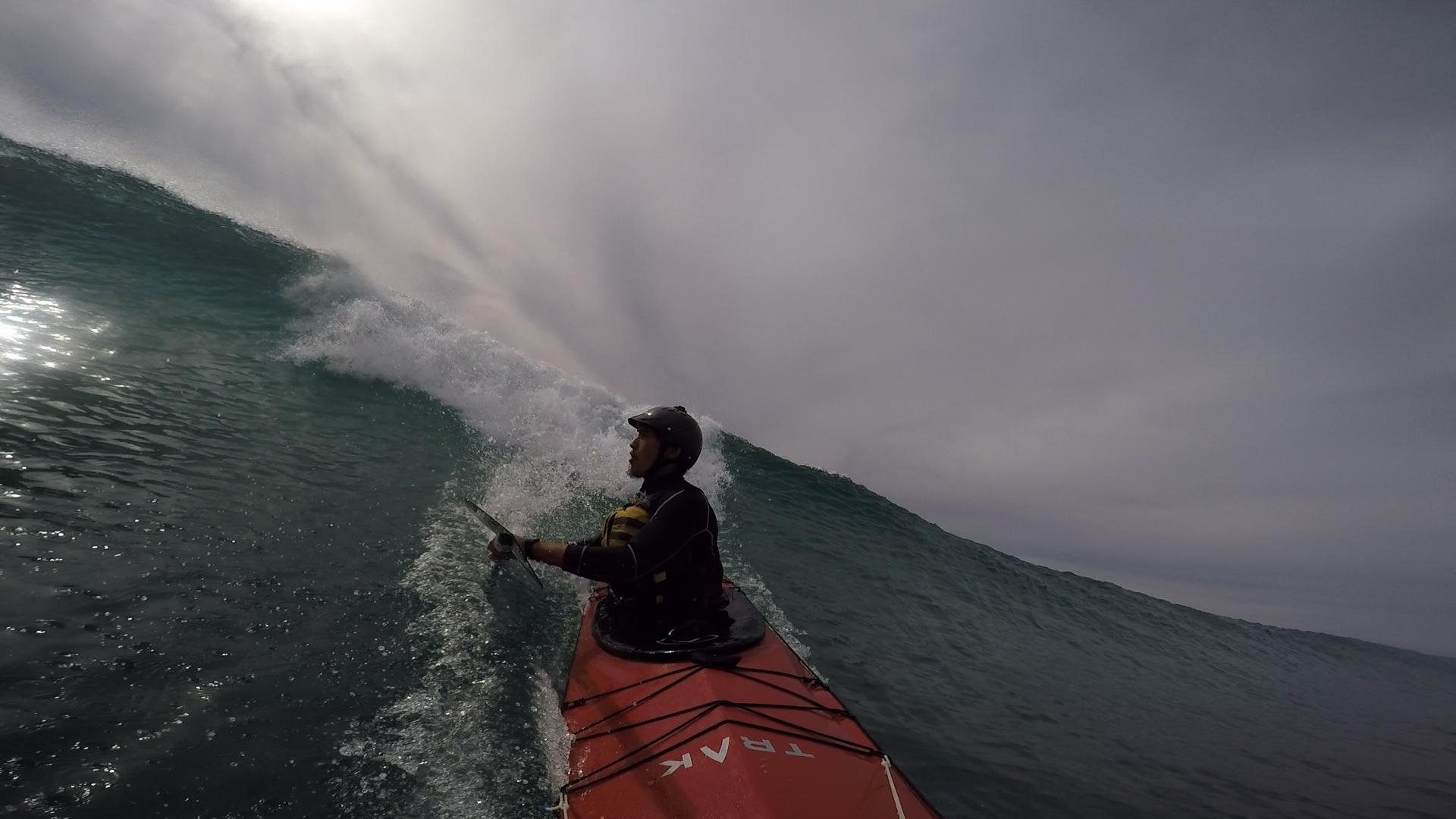 Pilot Ted Tetrault braves the surf in Baja in the original TRAK kayak.