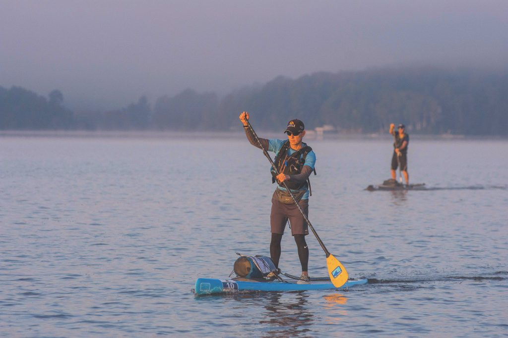 two men paddling their touring SUP's on calm waters