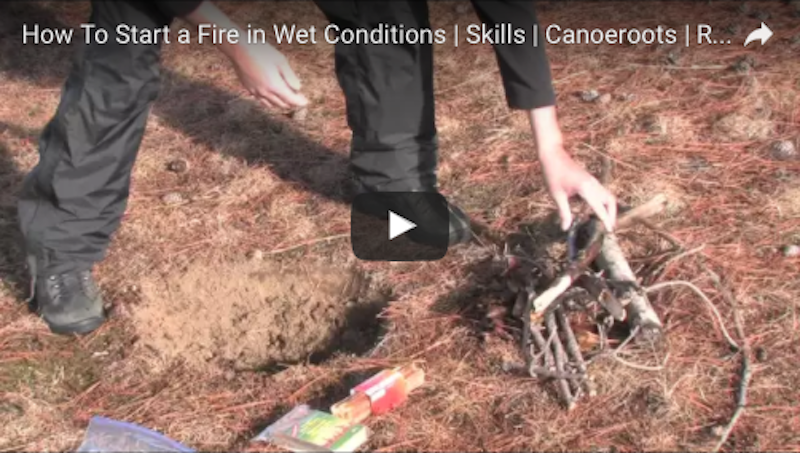 A screenshot of a video showing how to light a fire in wet conditions.