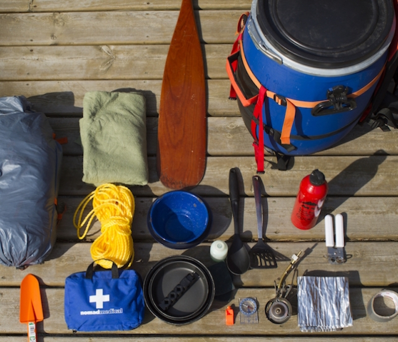 A collection of gear items to take on a canoe trip.