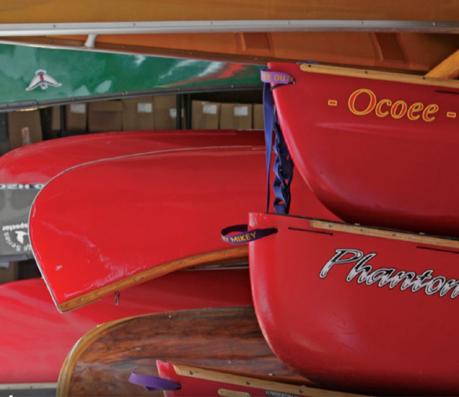 several canoes stored properly