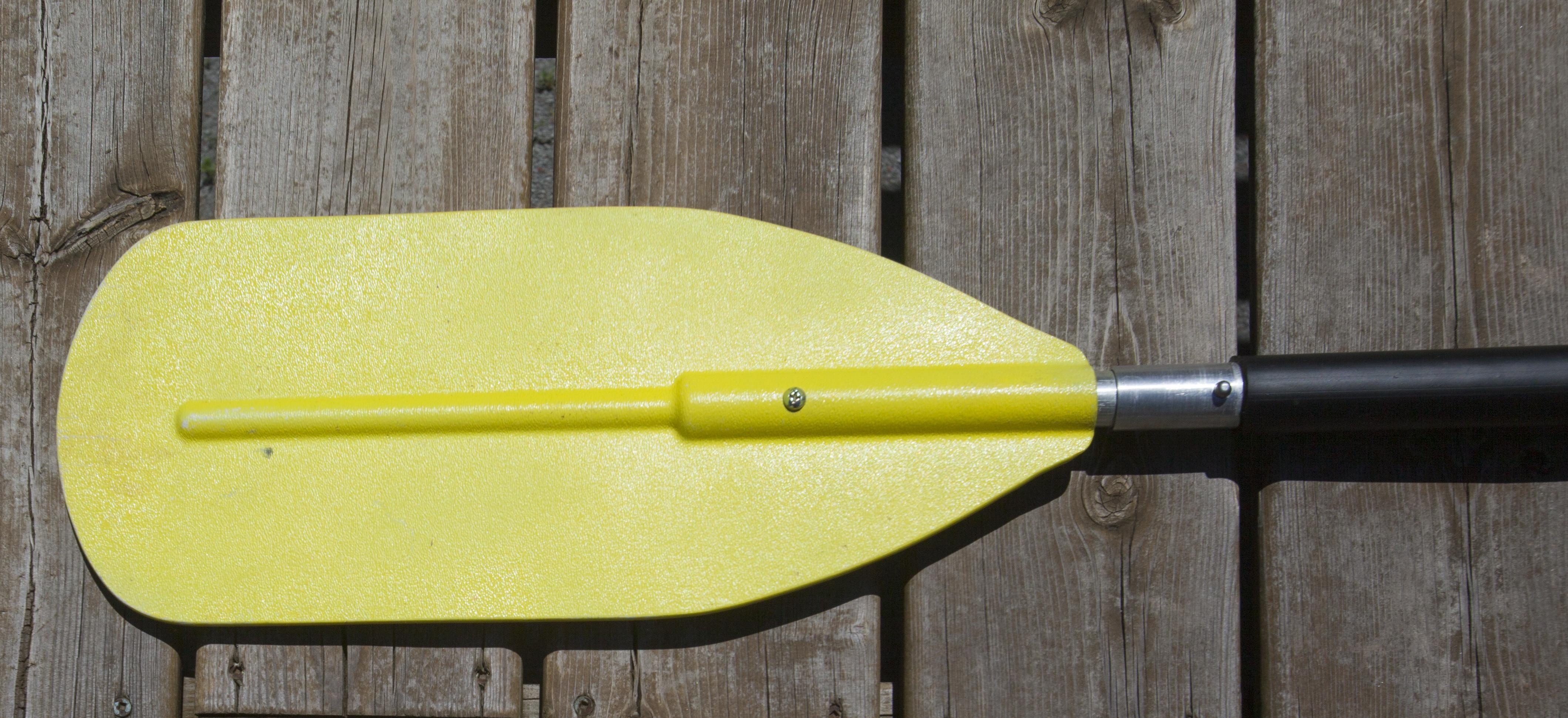 Ferrules on a yellow kayak paddle shaft