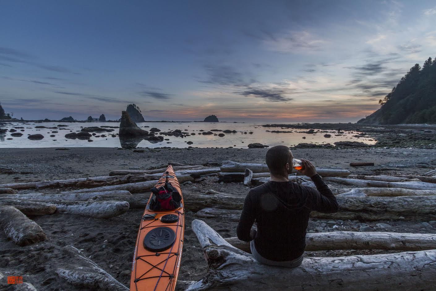 Daniel Fox's image of a kayaker and kayak on a beach during sunset.