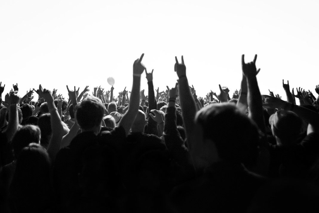 hands in the air with rock and roll symbol