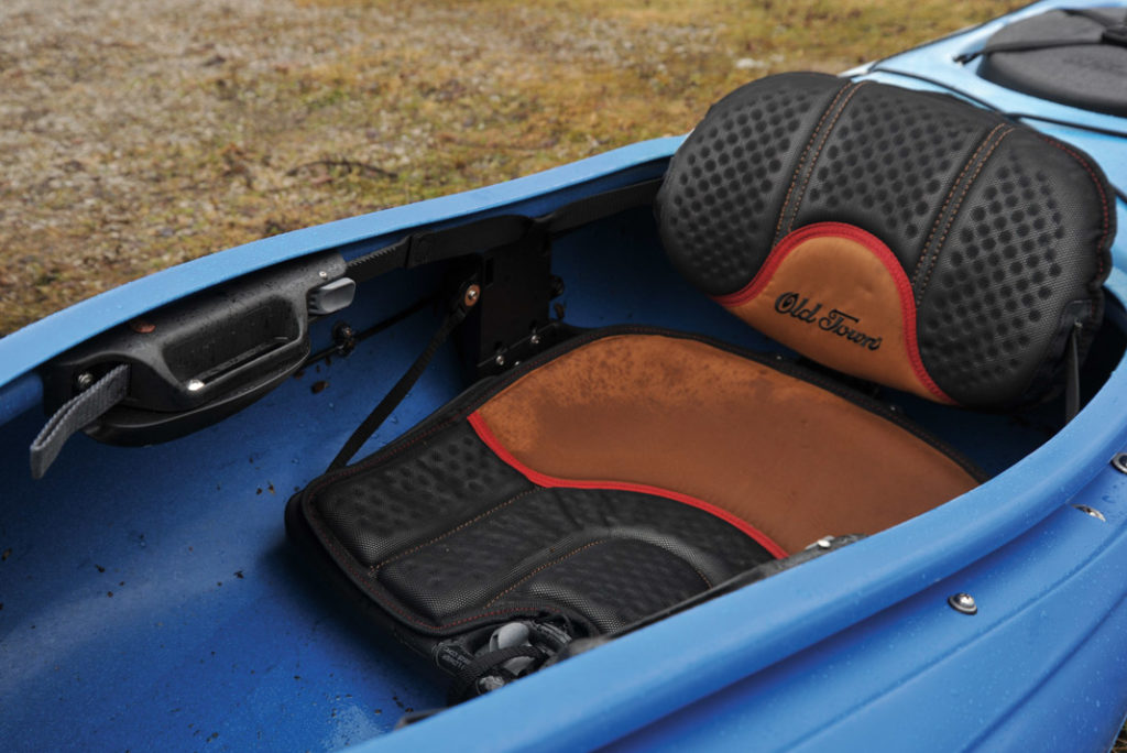 a black and brown seat in a kayak