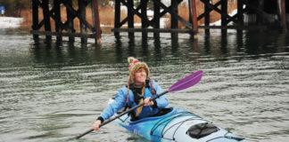 woman in a sea kayak paddling