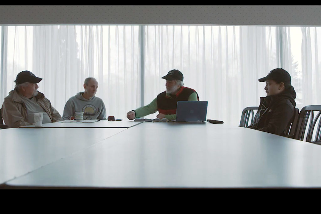 people having a discussion in a board room