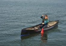 woman paddling in a swift cruiser 16.8 solo canoe