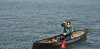 woman paddling in a swift cruiser 16.8 solo canoe