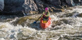 Mel Lindsay paddling Esquif Canoe's OC1 canoe down a rapid