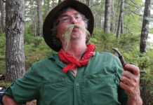 man in woods with a fake moustache