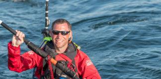 man smiling in a kayak