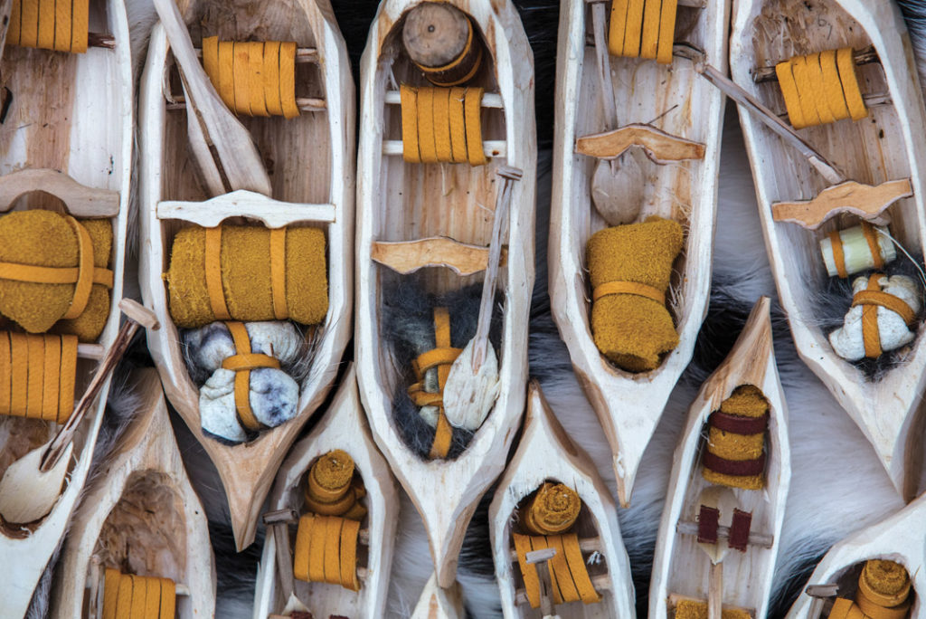 hand whittled canoes with decorations