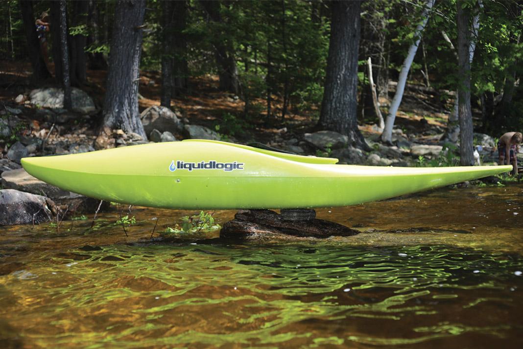 a kayak balancing on rocks