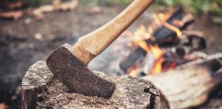 an axe in a log