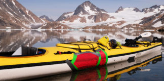 a sea kayak with patches