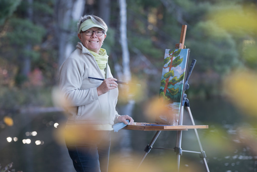 Burkholder painting in the wilderness