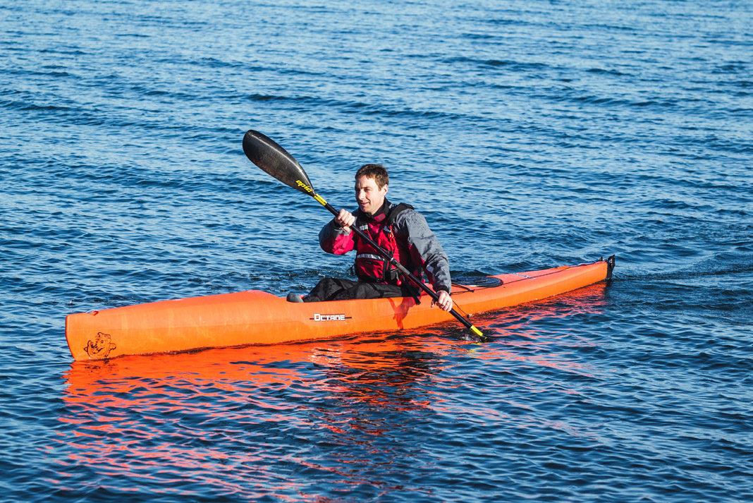 man in orange pyrahan surfs