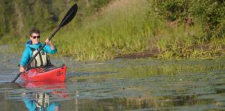 woman paddling Stellar Kayaks' Stellar Intrepid LV touring kayak