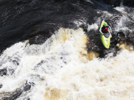 person running a rapid in Liquidlogic's whitewater kayak known as The Mullet