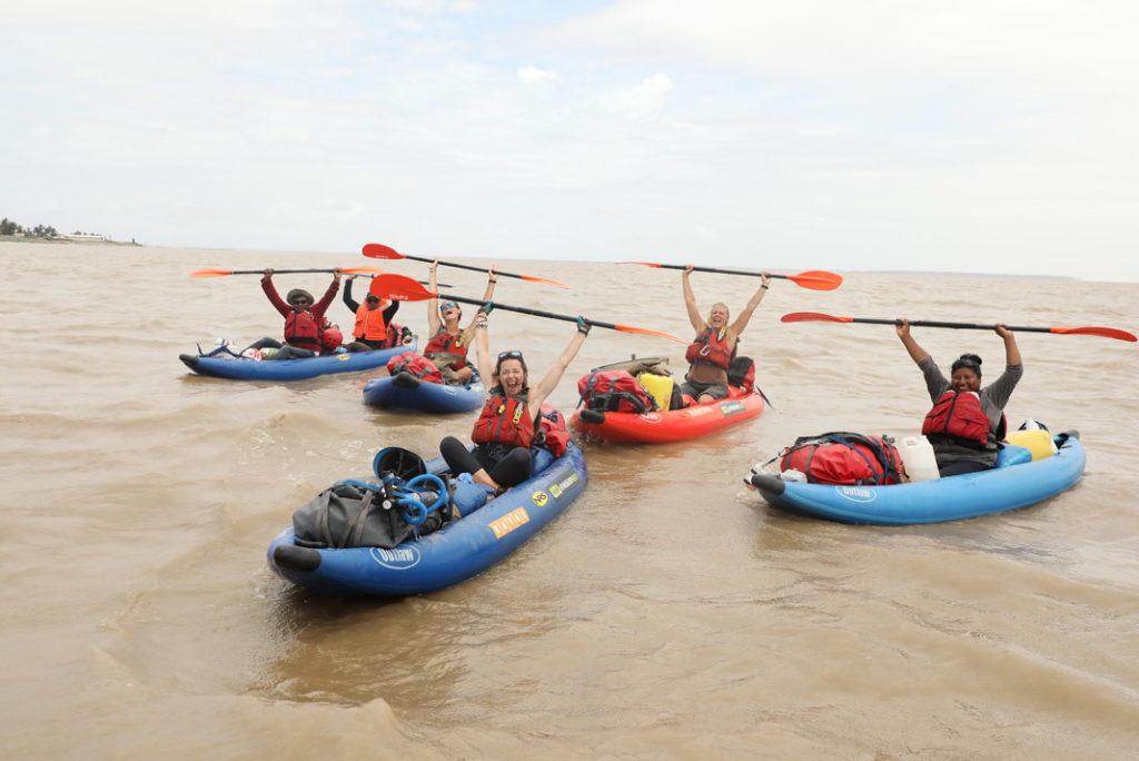 4 woman paddling inflatable kayaks