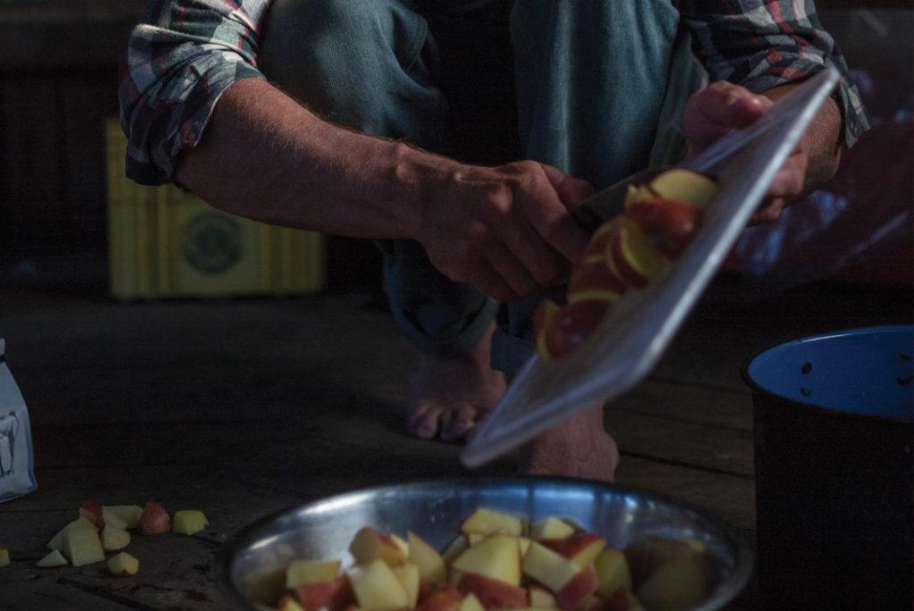 man cooking potatoes
