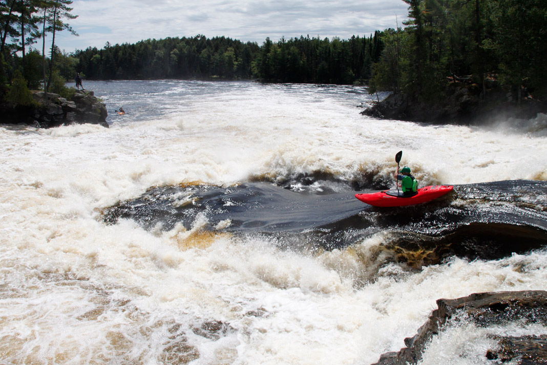 Graham Kent paddling Dagger Kayak's Phantom creek boat down Dragon's Tongue on the Ottawa River