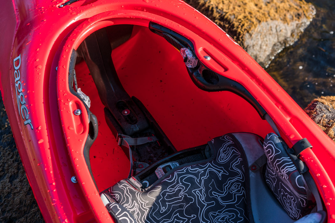 the interior of Dagger Kayak's Phantom racing kayak in red