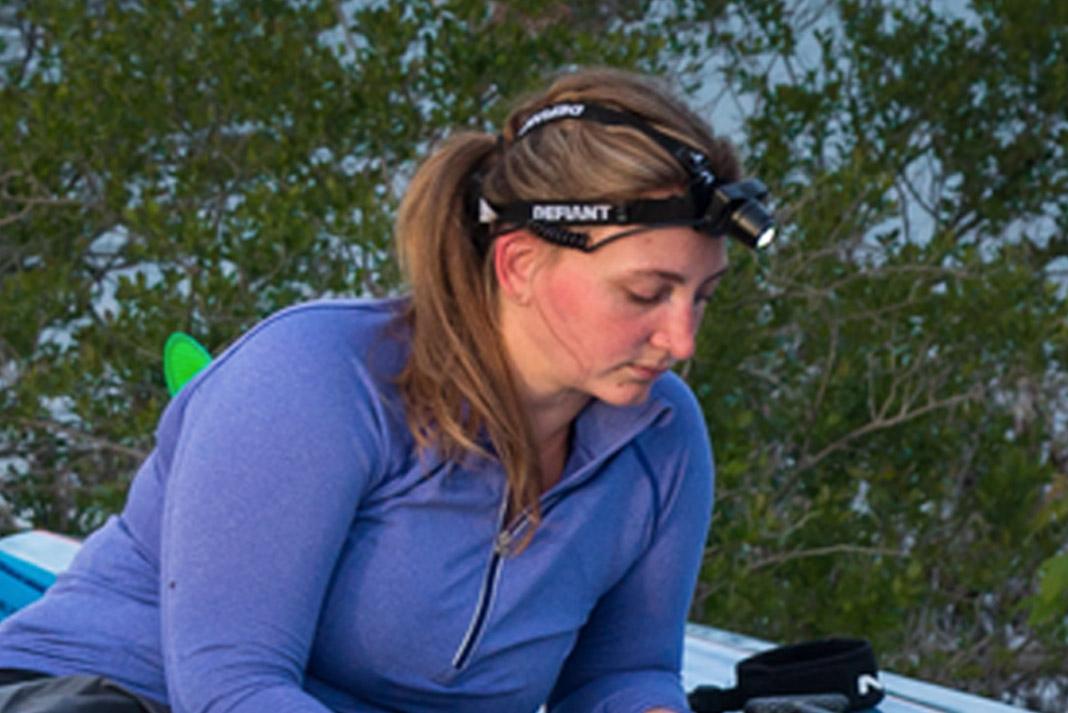 woman wearing headlamp