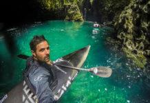 kayaker in emerald water