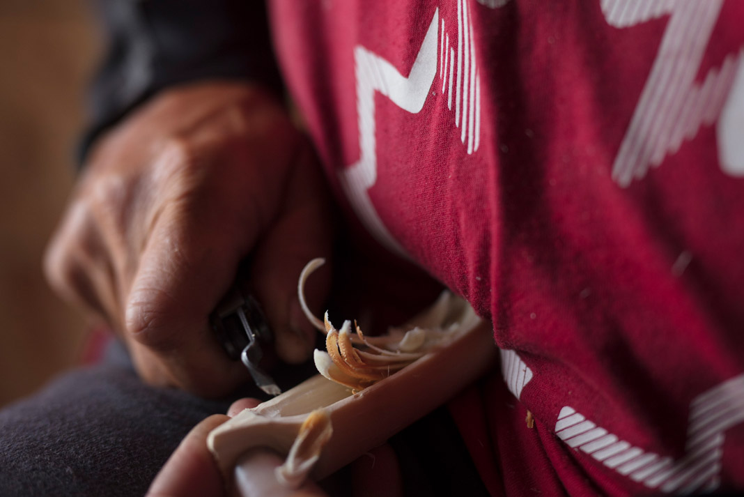 Mike Ranta hollows out the interior of his whittled canoe
