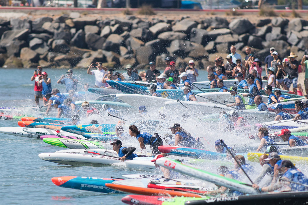 several paddleboard racers at the starting line