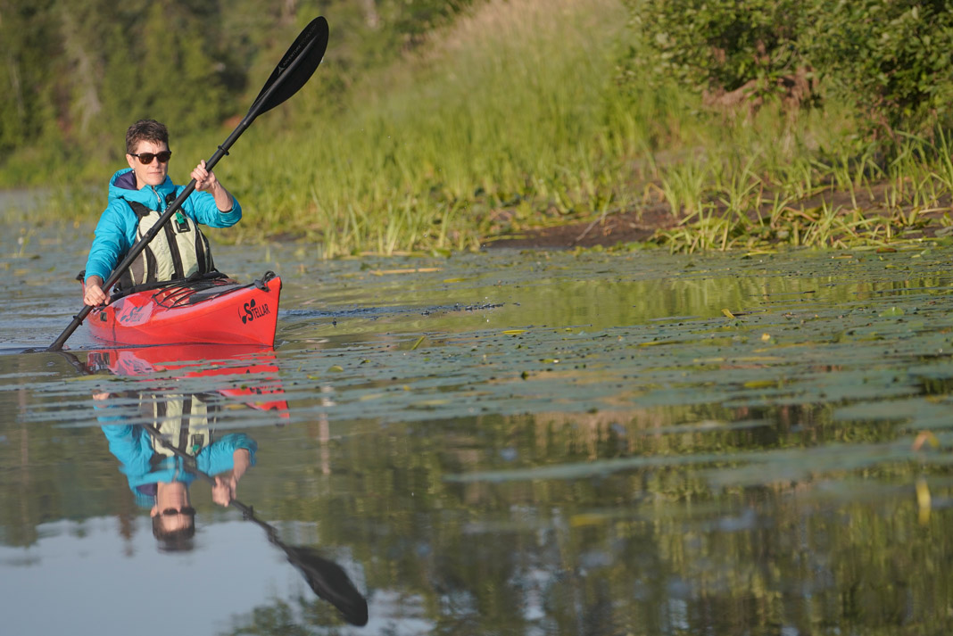 woman paddling Stellar Kayaks' Stellar Intrepid LV touring kayak
