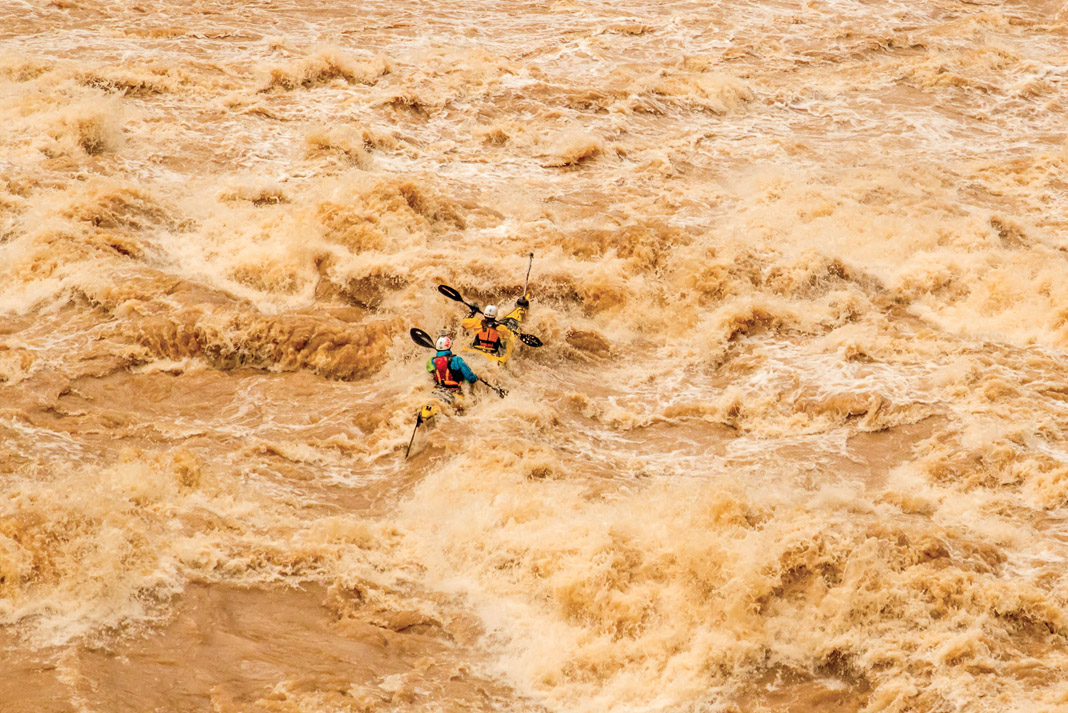 tandem sea kayak going through rapids