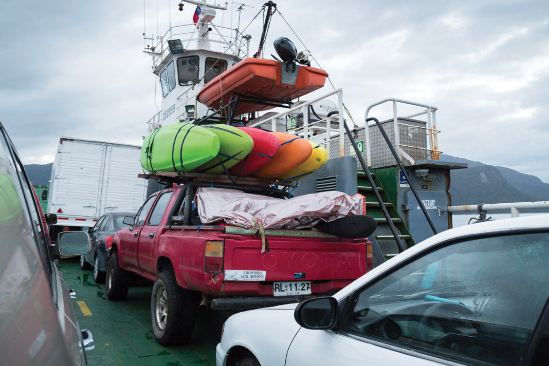 truck with several boats on top on a ferry