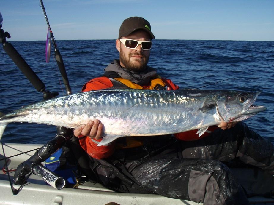 Kayak anglers mothership for big king mackerel off Hatteras, North Carolina. Photo: Justin Mayer