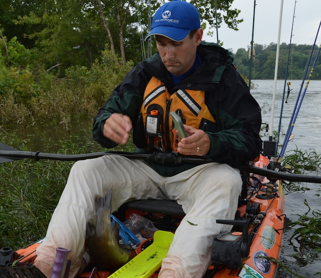 Jeff Little watches a smallmouth bass flip out of his hawg trough. Just another tourney day. Photos: Jeff Little