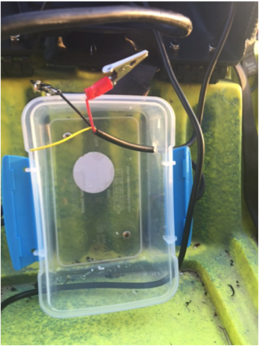 A plastic container is attached to the fishing kayak to house the fish finder battery.