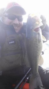 Mental toughness leads kayak fisherman to hold up a trophy bass