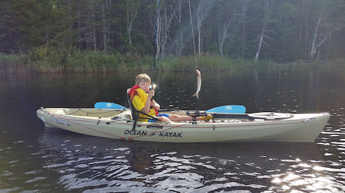 Joe Tilley's son Rowan paddling and fishing by himself for the first time.