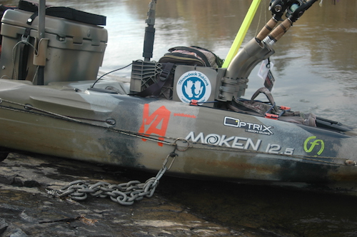 A closeup picture of fishing rod holders behind the seat of a Moken 12.5 fishing kayak.