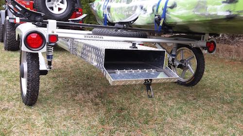 The rear view of Craig Hefner's Old Town Predator Fishing Kayak strapped to a kayak trailer