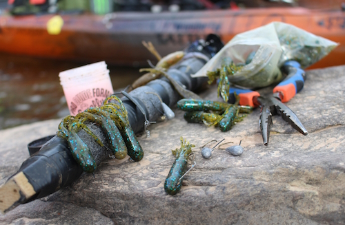 A close-up shot of fishing lures attached to foam on a rig-stick.