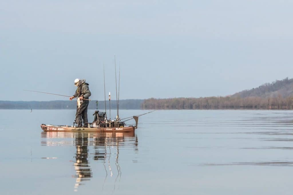 Angler standing and fishing