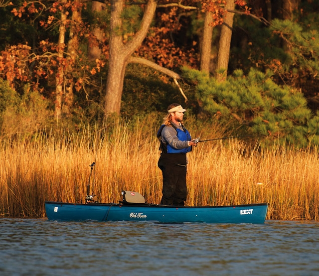 angler standing up in Old Town Canoe's NEXT hybrid kayak