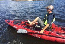 angler pedalling Old Town Canoe's Predator PDL fishing kayak