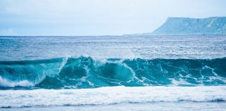 crashing breakers on the beach in Guam, a paradise for kayak fishing
